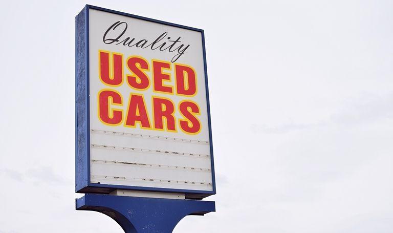 A used car sign on dealer lot