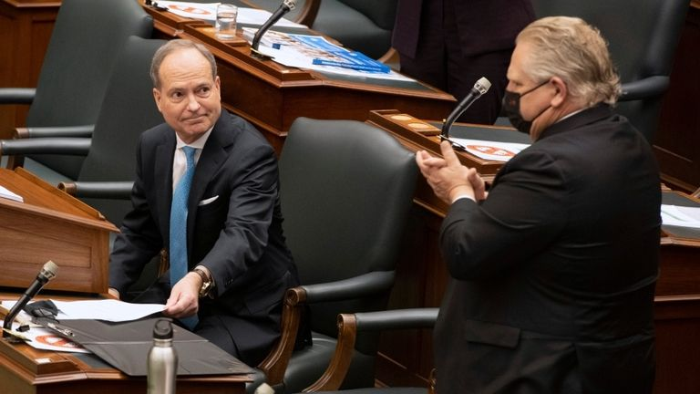Ontario Finance Minister Peter Bethlenfalvy, left, andPremier Doug Ford