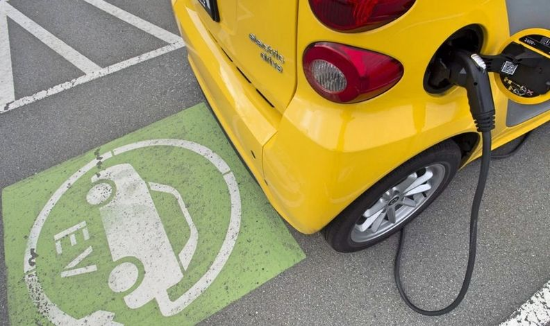 An Electric Vehicle Plugged Into a Public Charger