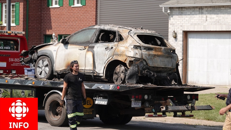 A burned out Hyundai Kona on a flatbed tow truck after the car allegedly exploded.