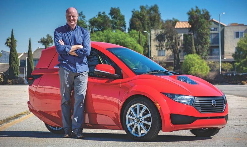 Electra-Meccanica President Paul Rivera with a Solo EV